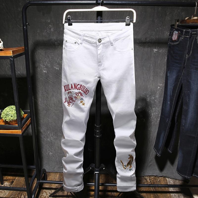 Mode personnalité hommes broderie Jeans printemps automne Slim Long pantalon hommes garçons Smart pantalon tigre homme Jeans grande taille