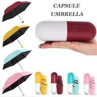 Plegable Mini cápsula paraguas con píldora caja de paquete de bolsillo sombrilla lluvia anti-UV portátil paraguas viajes soleado día lluvioso