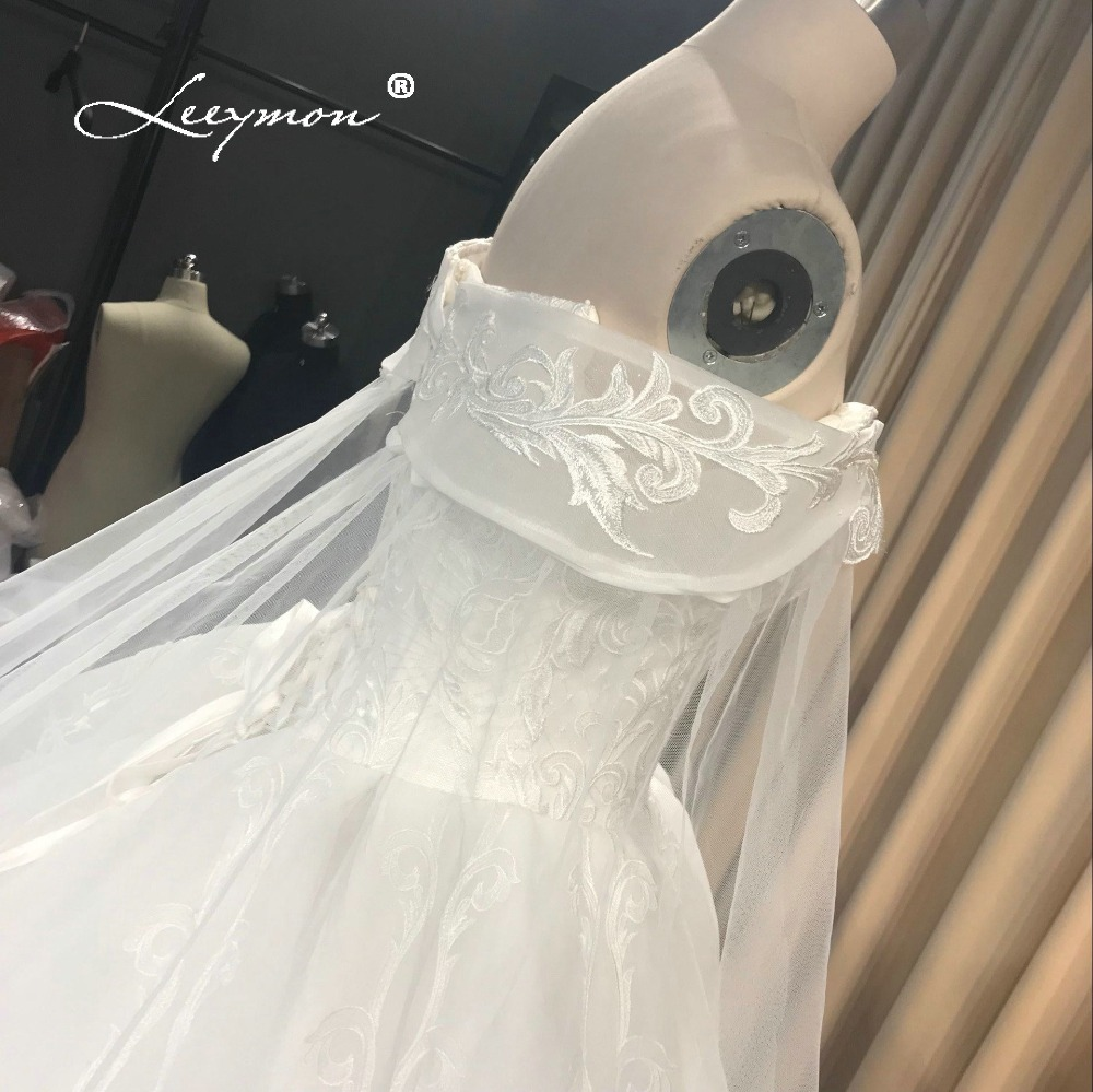 Leeymon Custom Made 2018 Free Shipping Wedding Dress Elegant Cap Sleeves  Lace Flower Ball Gown Wedding Dress Real Pictures-in Wedding Dresses from  Weddings ... f5d88c9a5073