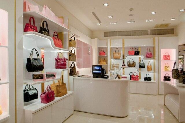 Diseno decoracion para tienda de bolsos exhibidor para for Decoracion de negocios de ropa