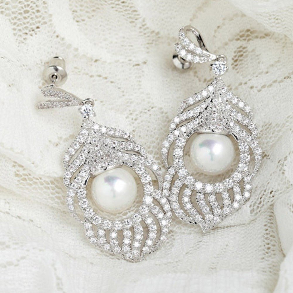 Luoteemi luxury heavy big chandelier feather earrings aaa cubic luoteemi luxury heavy big chandelier feather earrings aaa cubic zirconia mirco paved imitation pearl bridal jewelry for women in drop earrings from jewelry arubaitofo Gallery