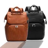 Nueva mochila de cuero de PU para pañales de bebé de calidad de moda Unisex + almohadilla de cambio + correas para cochecito