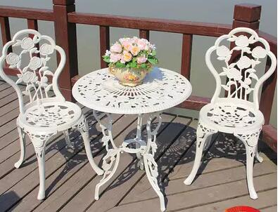 The garden table. Cast aluminium table and chair three pieces the silver chair