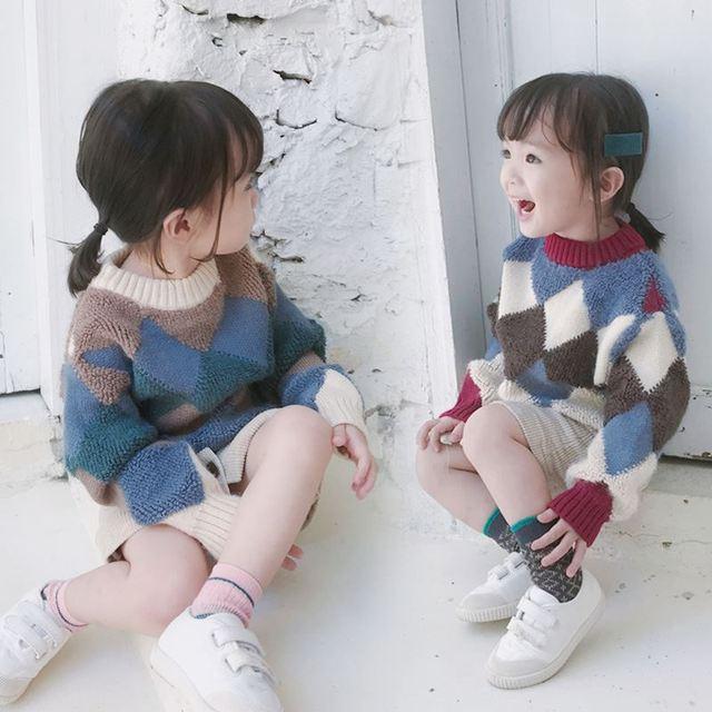Coreano di stile delle ragazze dei ragazzi rombo lavorato a maglia rotondo del collare maglioni casuali del capretto caldo addensare maglione del tutto-fiammifero di abbigliamento per bambini