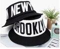 2015 nuevas cartas moda impreso algodón negro de cima plana sombrero de pescador hombres y mujeres parejas de la calle del verano Jordan sombrero del cubo
