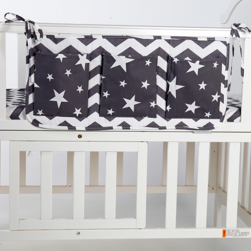 baby bed hanging storage bag cotton newborn crib organizer toy diaper pocket for crib bedding. Black Bedroom Furniture Sets. Home Design Ideas