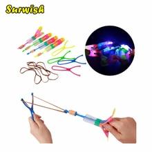 Surwish Large LED Light Slingshot Elastic Arrow Rocket Helicopter Flying Toy Party Fun Gift – Color Random