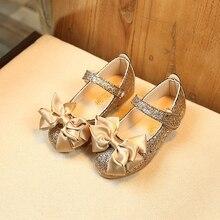 eefad7286 طفل الفتيات أحذية من الجلد غير زلة الترتر القوس فتيات صغيرات يتدربن على  المشي الأميرة أحذية خف مغلق من الأمام شقة الأحذية الذهب .