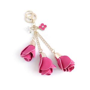 Image 1 - Dhlfree 100pcs 18 색 매력 가죽 장미 꽃 열쇠 고리 술 꽃 열쇠 고리 여성 열쇠 고리 가방 지갑 펜던트 쥬얼리