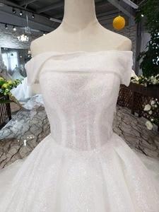 Image 4 - LSS505 strapless wedding dresses boho off shoulder corset white shiny wedding gowns with train new fashion платье атласное