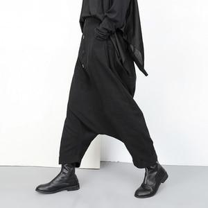 Image 2 - [EAM] جديد ربيع خريف 2020 عالي المرونة الخصر الأسود زر انقسام مشترك واسعة الساق السراويل الطويلة فضفاضة النساء بنطلون موضة YG2