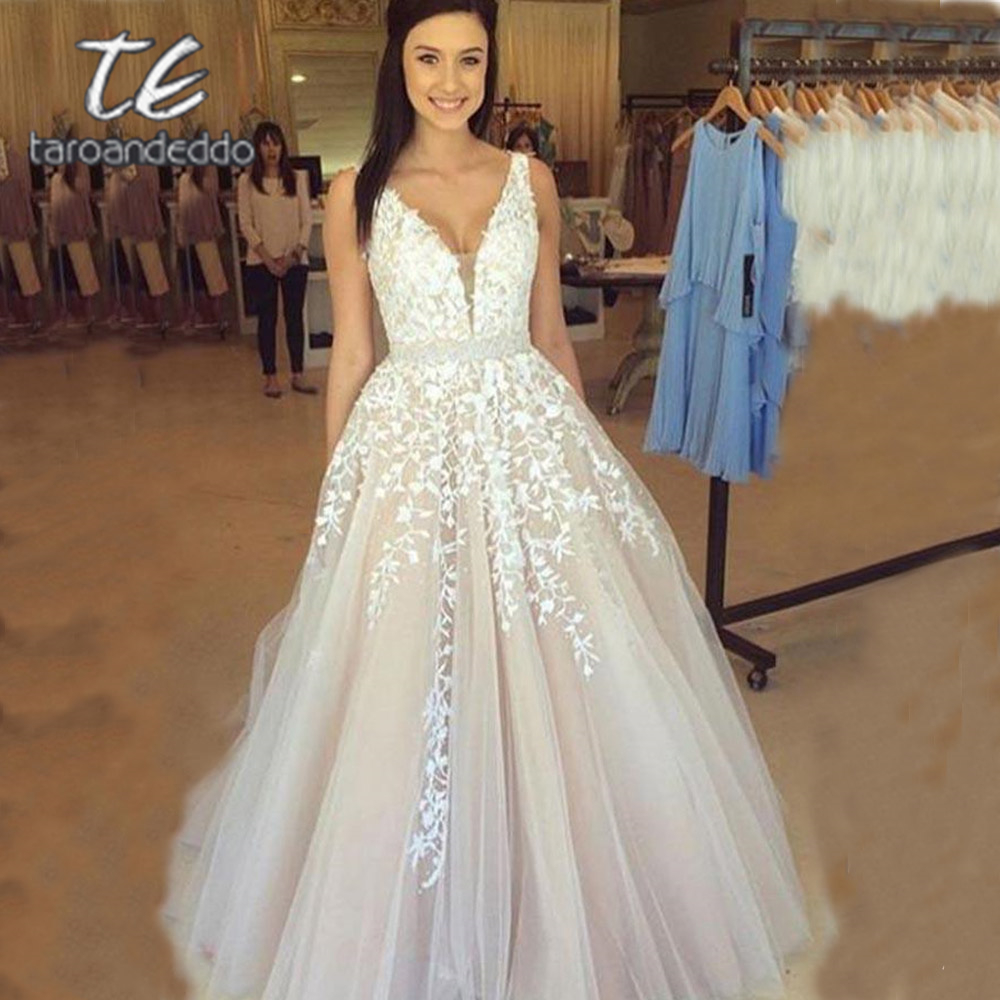 Wedding-Dresses Light Champagne Applique Open-Back A-Line Backless Floor-Length V-Neck title=