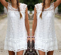 Summer dress sexy mujeres sin mangas ocasionales de playa corto dress tassel solid blanco mini lace dress