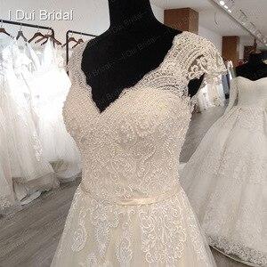Image 5 - Boné manga v decote vestido de casamento com pérola de luxo frisado delicado laço nupcial vestido de alta qualidade fábrica feito sob encomenda
