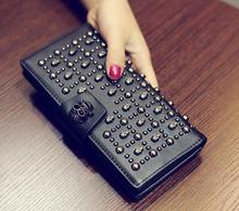 The new 2016 skulls ms long wallet Europe and the United States women's fashion and personality rivet hand bag BaoChao phone