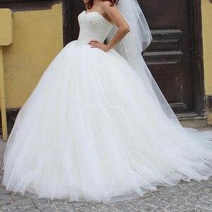 Image 3 - Sin mangas de tul esponjoso encaje hasta vestidos de novia de boda blanco marfil lujoso perlas Boda de Princesa vestidos