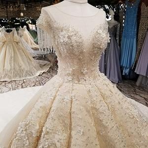 Image 4 - קיצוני יוקרה ללא שרוולים סקסי בציר חתונה שמלות 2020 קריסטל פרחי מותאם אישית high end טול הכלה שמלה