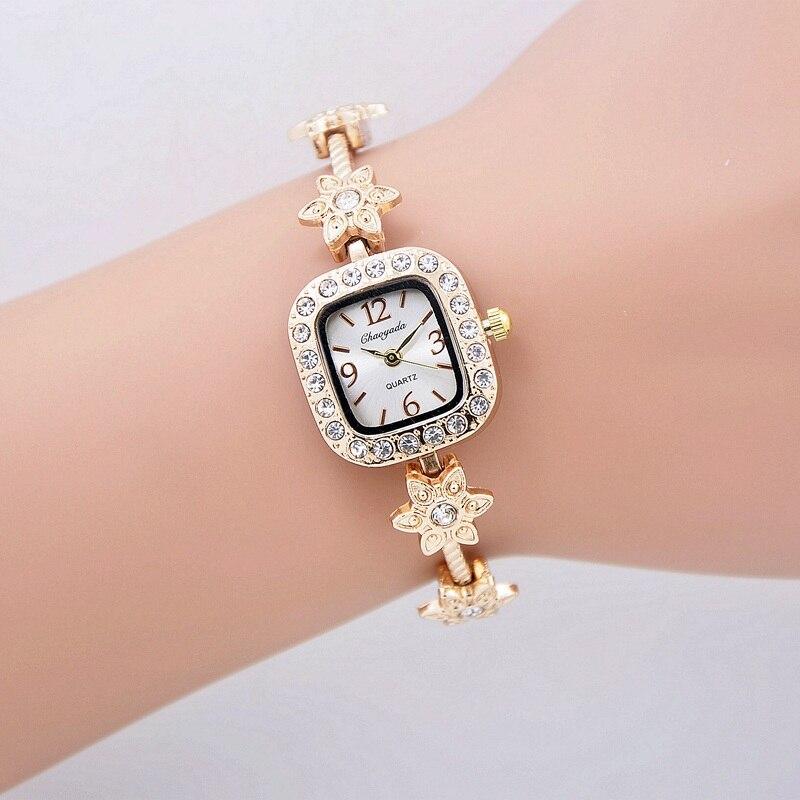 f875b7b3f525 Cuarzo de las señoras relojes de oro reloj mujeres vestido relojes Top marca  de lujo con chaoyada banda Relogio feminino reloj Mujer