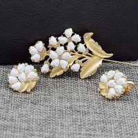 New European and American retro models  lily orchid imitation pearl inlaid flower brooch ear clip suit combination female