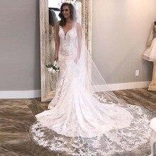 Laço luxo Vestidos de Casamento Com Decote Em V Apliques de Renda Branco Marfim Vestido De Boda Vestido de Noiva Ilusão Botões Voltar Vestidos de Casamento