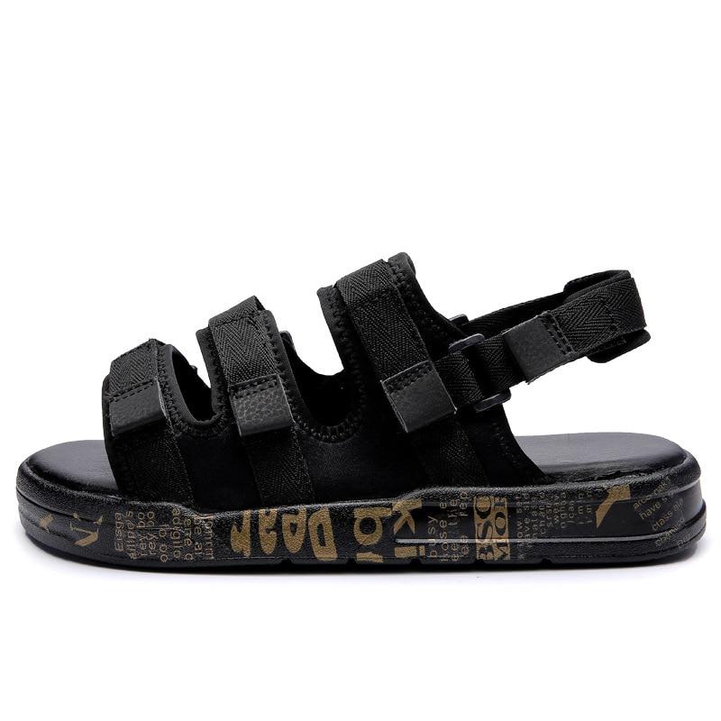 44cb4c97f90 2018 Summer New Korean Wave Vietnamese Beach Sandals and Slippers Men  Breathable Black Wild Magic Stickers Sandals Men Shoes