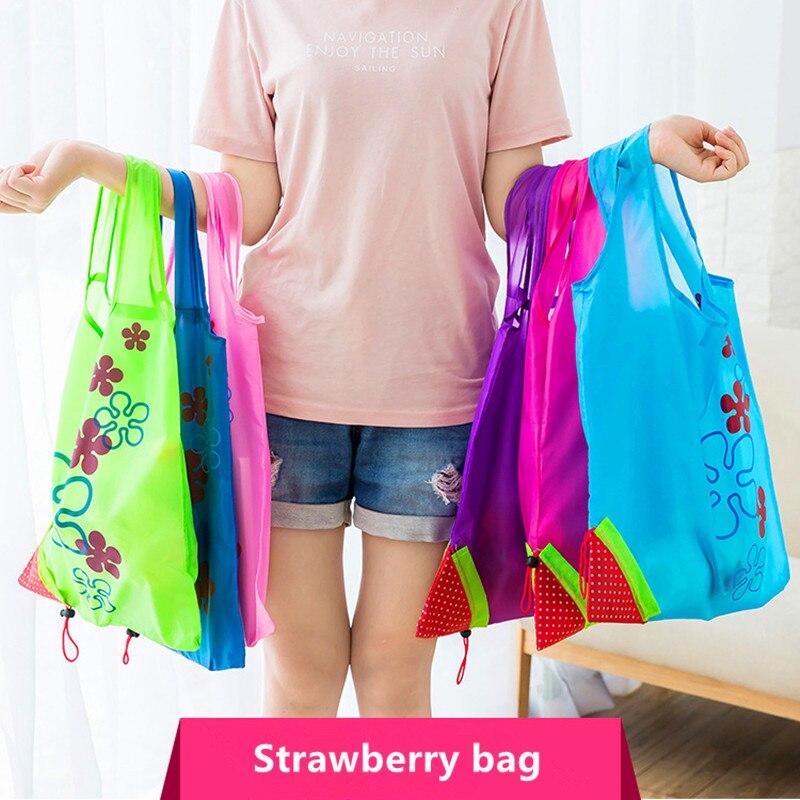 Bolsa de almacenamiento ambiental creativa caliente bolso de compras plegable de fresa bolsa de compras reutilizable plegable de Nylon bolsa de mano ecológica