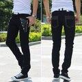 2015 Nueva moda Marca Europea delgado mens casual negro/blanco personalidad cráneo remache Pantalones para hombre pantalones flacos