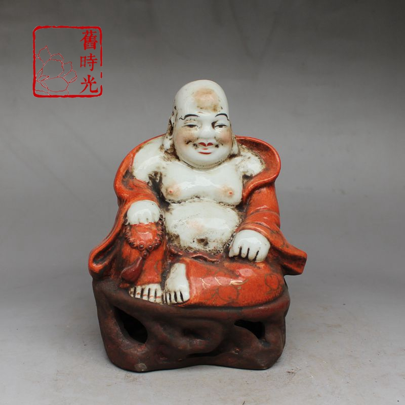 The red glaze of archaized ceramics depicts the golden Maitreya Buddha.The red glaze of archaized ceramics depicts the golden Maitreya Buddha.