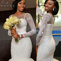 Sexy African White Sweetheart Mermaid Wedding Dresses 2017 Court Train Sheer Back Applique Beaded Bridal Gown robe de mariage