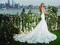 Arabic 2017 White Mermaid Princess Backless Lace Wedding Dresses Sexy Sheer Spaghetti Straps Wedding Gowns Bride Dresses