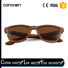 2017 fashional brown polarized lens with spring metal frame with ebony skateboard wooden sunglasses