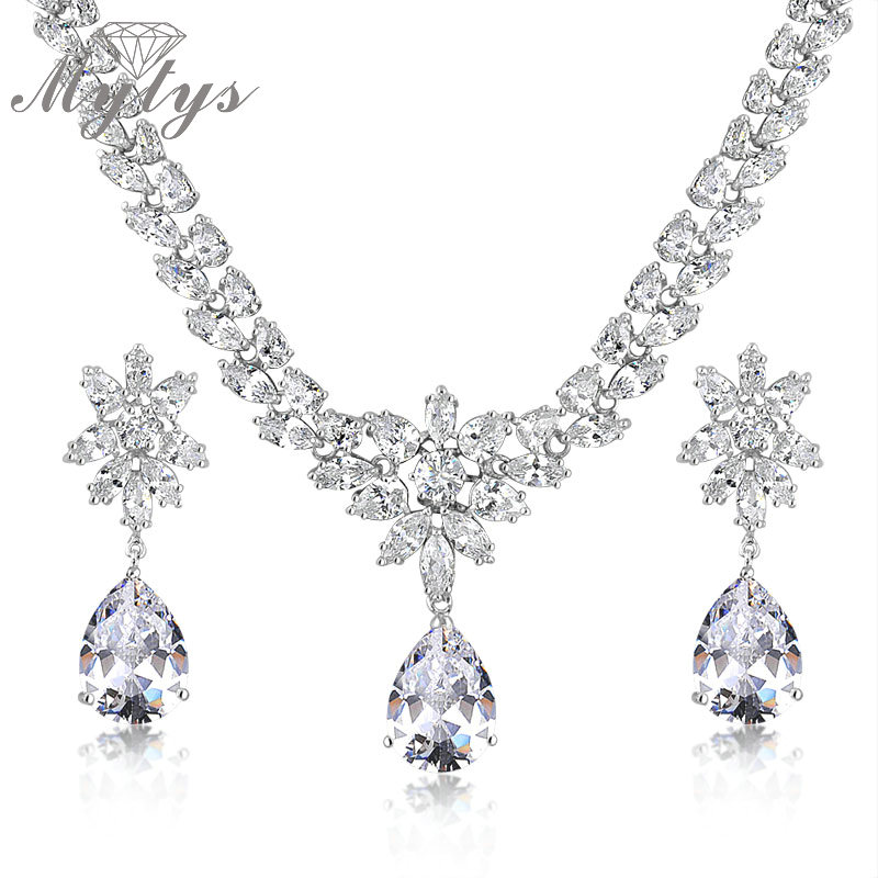 Mytys High Quality Snow White Transparent Shining Crystal Jewelry Sets Crystal Pendant Necklace and Drop Earrings Sets CN156 недорго, оригинальная цена