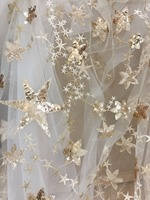 Top quality 3D gold sequin star embroidery lace fabric in champagne tulle for cocktail dress, gowns, bridal veil haute couture