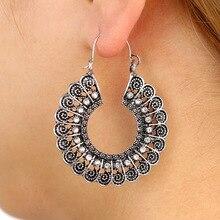 купить 2018 Bohemian Vintage Hollow Metal Dangle Earrings Women Gypsy Ethnic Tribal Carved Crescent C-shaped Opening Earrings Jewelry по цене 71.64 рублей