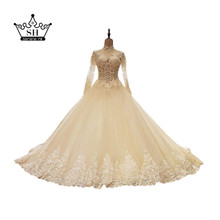 Sexy Sheer High Neck Tassels Wedding Dresses 2017 See Through Long Sleeve Beaded Sequins Backless Bridal Gowns Vestido De Noiva