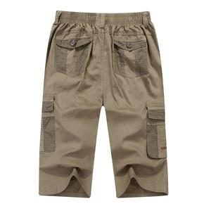 Image 2 - Zomer Mannen Safari Stijl Cargo Shorts Pocket Katoen Plus Size 6XL 7XL 8XL Man Casual Elastische Taille Shorts Stretch kaki 46