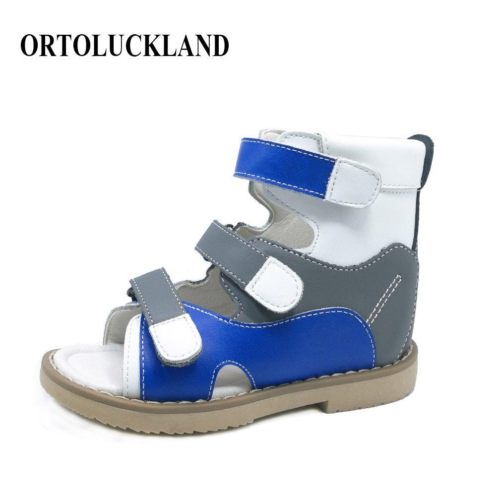 Chaussures en cuir véritable de cheville d'enfants de couleurs mélangées européennes populaires chaussures orthopédiques sandales de pied plat de garçons avec le soutien d'arc