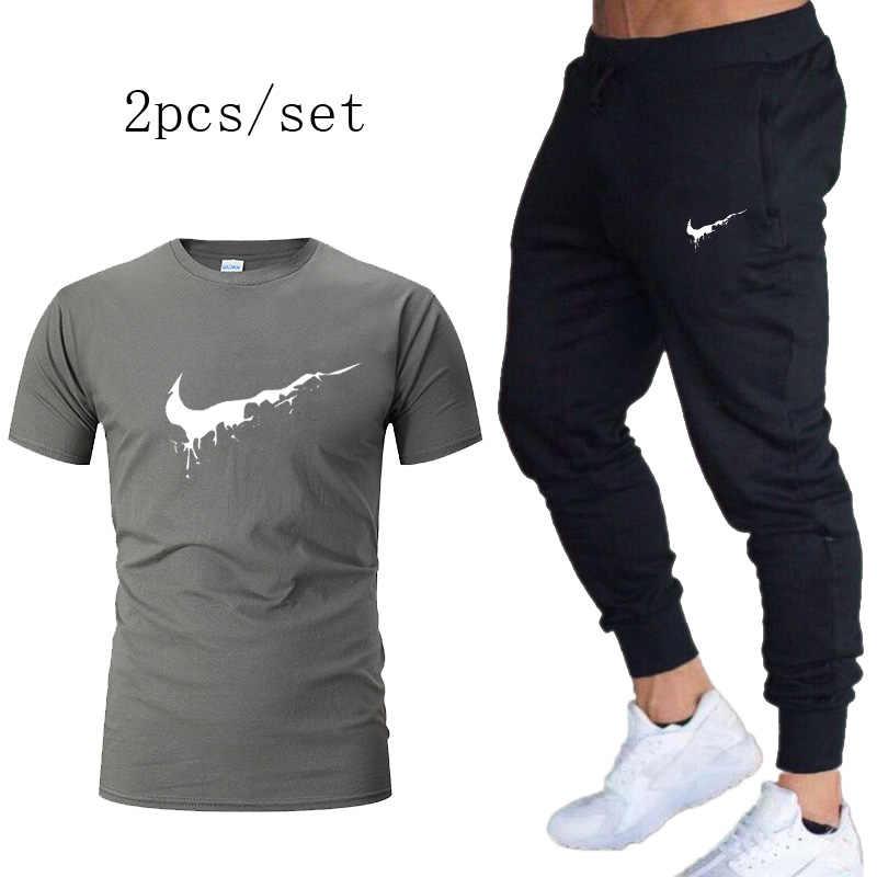 Gym Kaos Olahraga Pria Jogging Berjalan T Kemeja + Celana Pria Merek Pakaian Latihan Yg Hangat Menjalankan Olahraga Tshirts Gym Latihan kebugaran 2 Buah/Set