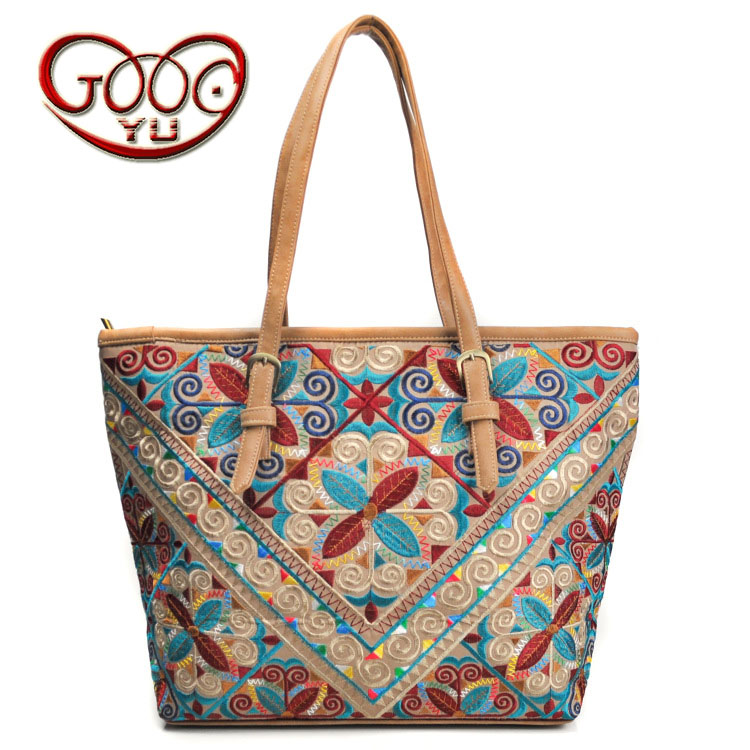 China 's Yunnan national style PU leather women' s handbag geometric pattern casual cross style square shoulder bag