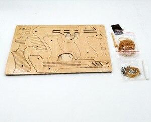 Image 3 - Pistolet à ruban en caoutchouc, découpe Laser, Puzzle en bois 3D, Kit dassemblage artisanal en bois, chasse, loup, aigle, Train, Dragon, cadeau de noël