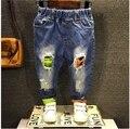 2016 nueva muchacha del muchacho agujero Jeans niños del resorte de los bebés de mezclilla pantalones para niños ropa