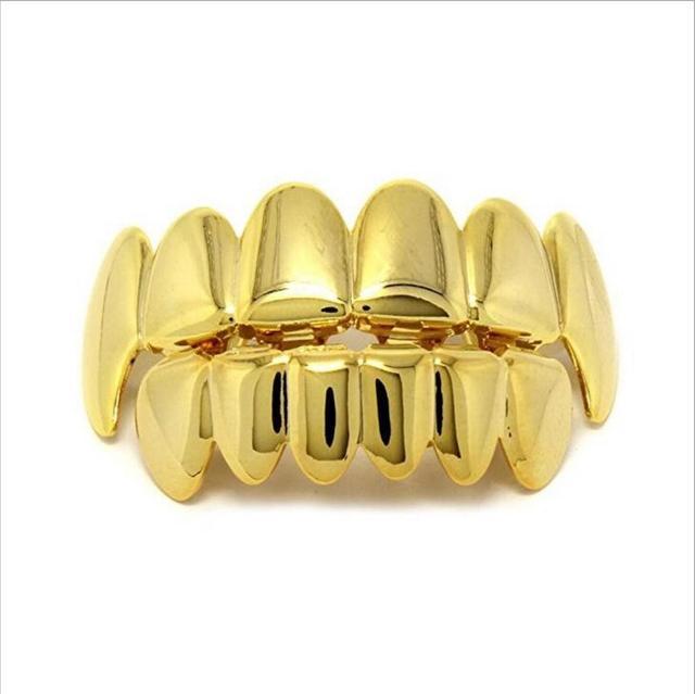 Hip Hop Gold Teeth Grillz...
