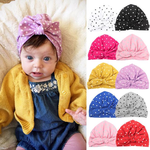 6ab68f0dc88 Cute Baby Girls Bun Knot Turban Head Wrap Cute Kids Ear Bowknot Polka Dot  Hat Cotton Cap for 1-2Y Children Girls