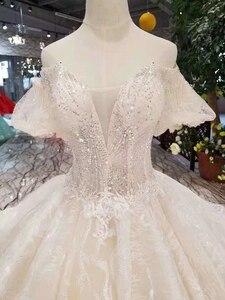 Image 4 - LSS206 샴페인 레이스 웨딩 드레스 2020 짧은 플레어 슬리브 섹시한 v 백 웨딩 드레스 우아한 11.11 글로브 쇼핑 축제