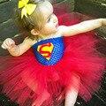 Niñas bebé de la manera ropa de diseño de alta calidad de dibujos animados traje de superman bebé vestidos del tutú de navidad