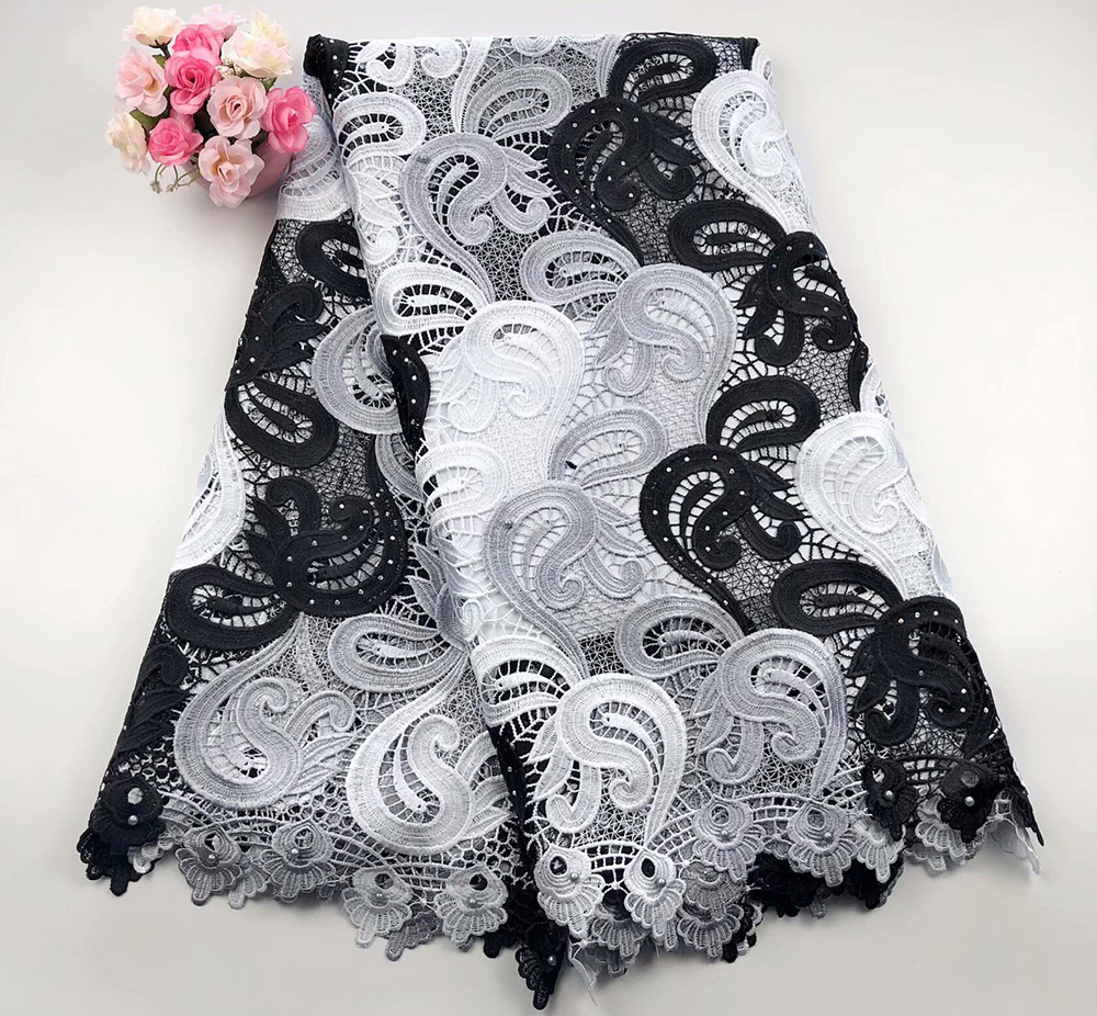 Most Popular High Quality Nigerian Embroidered African Lace Fabrics Blue Color Guipure cord lace fabric for wedding dressMost Popular High Quality Nigerian Embroidered African Lace Fabrics Blue Color Guipure cord lace fabric for wedding dress