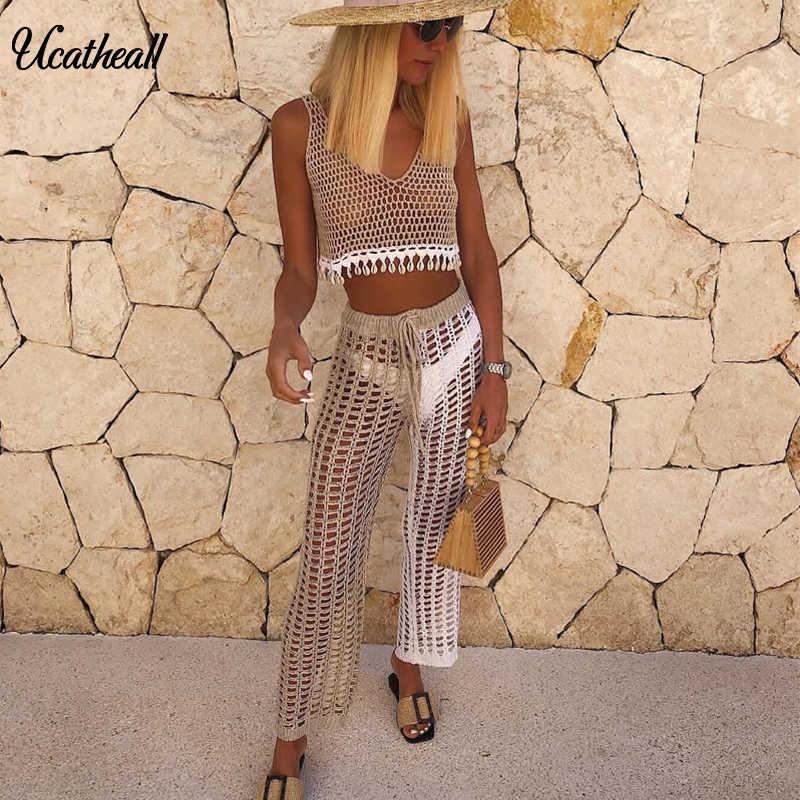 Kadın yaz plaj örme oymak pantolon See Through tığ düz pantolon seksi Hollow Out Fishnet geniş bacak pantolon