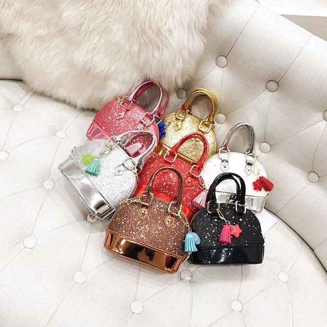 Children's bag 2018 new single-shoulder package cute sequins mini shell wrap tidal slant cross accessory bag