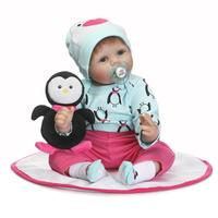 NPKCollection Fashion 55cm Simulation newborn baby with Little penguin clothes Lovely Baby toys silicone reborn baby dolls