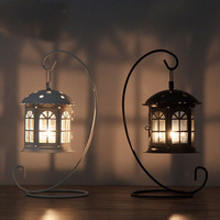 Nordic classic wrought iron windproof hanging candlestick glass door restaurant candlelight dinner decoration wind lamp